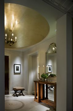A gilded dome ceiling, white Venetian plaster and onyx floor encircled by brass inlay #interiordesign