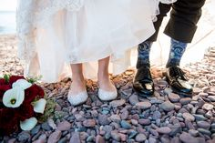 Epic photos from weddings on Lake Superior near Duluth, MN. #bryanjonathanweddings #mnweddingphotography #duluthweddingphotographers #weddingsonthebiglake #minnesotaweddings #summerweddingsonlakesuperior #aerialliftbridgeweddingpic #duluthlakewalkwedding #rosegardenwedding