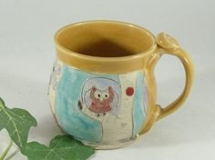 Coffee Mug, Handmade Ceramics and Pottery Mug, Hand carved ceramic coffee mug, Owl Mug, ceramic tea cup, stoneware mug, gift for boss  This coffee mug is perfect for anyone who likes a cup of coffee or tea in an artistic, handmade cup. This colorful cup is great piece of pottery as well as a work of art. Its perfect for hot tea, coffee, chai, hot chocolate or any other favorite beverage. I made this on my pottery wheel out of durable stoneware clay, carving in the woodland design complete…