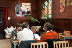 World Peace cafe , Huddersfield. Relax and unwind in this café in a church that has been converted into a residential Buddhist centre. In summer you can picnic in the gardens, and in winter the café has a wood-burning fire. All food is home-cooked and organic where possible.