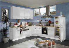 #Kitchen of the Day: A bright space with blue walls, high windows, and modern white cabinets manufactured by ALNO and designed for efficiency... Picture # 55 in Modern White Kitchens (Alno.com, Kitchen-Design-Ideas.org)
