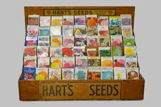 Harts Seed Display w/ Packets 23 Craft Books, Book Crafts, Country Store Display, Vintage Seed Packets, Future Shop, Seed Packaging, Catalog Cover, Shop Ideas, Crates