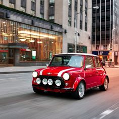 BMW has unveiled a one-off, all-electric version of the classic MINI car. Find out more on Dezeen. #minicooper #cardesign