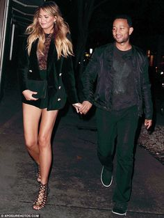 Loved-up: Chrissy Teigen, 29, went braless for her romantic night out with husband John le...