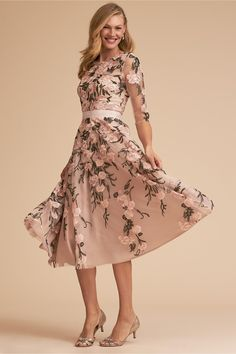 Pretty, polished, and just a little bit playful, this vintage-inspired dress flatters with its a-line silhouette and illusion detailing on the decolletage and sleeves. Embroidered floral embellishments and a satin ribbon add an elegant flourish. Mother Of Bride Outfits, Mother Of Groom Dresses, Mothers Dresses, Mother Of The Bride Dresses Tea Length, Mob Dresses, Tea Length Dresses, Bridesmaid Dresses, Wedding Dresses, Wedding Attire
