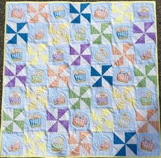 Animals on Parade Baby Quilt with soft pinwheels from http://www.homesewnbycarolyn.com