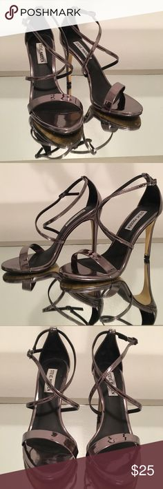 """Steve Madden Pewter Feliz strappy sandal sz 7 Sexy strappy sandal in shiny pewter (dark silver). Worn once to a banquet, still in very good condition. This is the """"Feliz"""" style from Steve Madden. Size 7 Steve Madden Shoes Heels"""