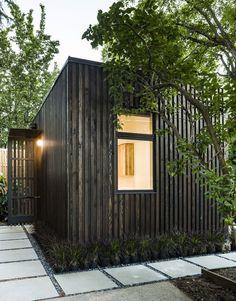 Tiny house with wood siding