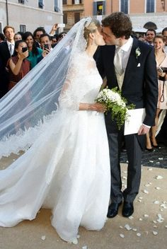 ready4royalty:  Wedding of Prince Amedeo of Belgium, Archduke of Austria Este, and Miss Elisabetta (Lili) Maria Rosboch von Wolkenstein, Rome, July 5, 2014-A kiss between bride and groom