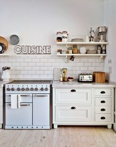 White Country Kitchen with Range Cooker and Timber Flooring  Darling stove! #bHomeApp
