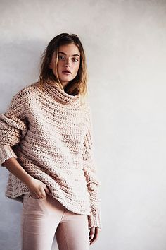 Keep cozy and warm in this chunky mock neck sweater featured in a boxy silhouette.