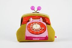 Color bobble pouch  Rotary in red and pink  metal by octopurse, $32.40