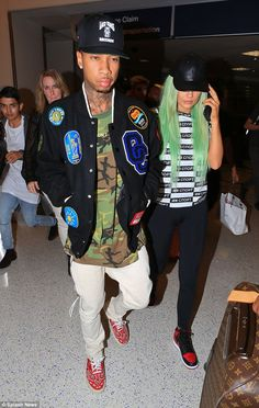 Green-haired Kylie Jenner keeps a low profile with Tyga at LAX #dailymail