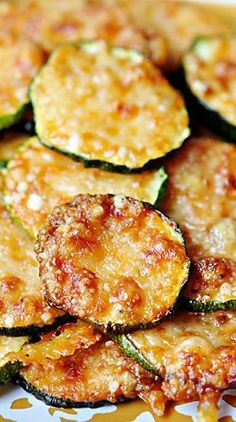 """Baked Parmesan Zucchini Rounds. Just had to post this...2 ingredients, about 5 minutes prep. YUM!"""