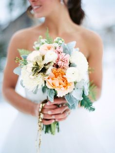 Winter bouquet with a touch of gold: http://www.stylemepretty.com/2016/07/14/forget-catching-pokemon-catch-these-wedding-bouquets-instead/