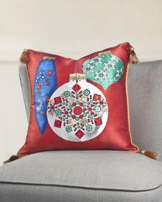 Balsam Hill's Sparkling Red Ornament Pillow brings a touch of glamor to your holiday home.