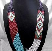 combo of bead weaving & stringing, using the colours of the weave. Hmmm. Could be very interesting.
