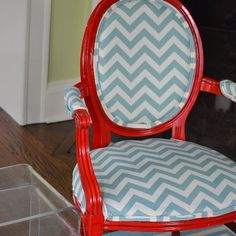 These craigslist armchairs were bland and in need of a makeover... some bright red spray paint and trendy chevron fabric later... so fun!