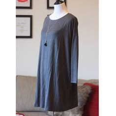 "Gray Shift Dress M/L Charcoal gray color. Loose fit, long sleeve.  This dress is made with heavyweight jersey that is soft and drapes beautifully. • 95% Rayon, 5% Spandex  • Super soft and comfortable • Loose fit, round neck and relaxed oversized fit M/L: BUST-27.5""  M/L LENGTH-34""   ✅Bundle & Save✅ ✅NWT Retail✅ ✅Same Day Shipping✅ Boutique Brand Dresses Midi"