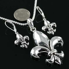 NEW!  FLEUR DE LIS NECKLACE AND EARRING SET.  COMES WITH 18 INCH CHAIN. BEAUTIFUL!!