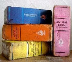 Book Bricks | 23 Lovely DIY Bookends To Adorn Your Shelves Copy the bookends in this pin by painting bricks to look like old books. Acrylic paints work just fine on stone.