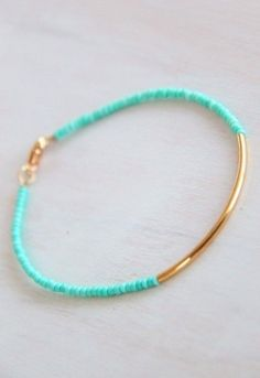 Small seed bead and gold tube bracelet
