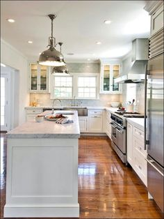 Beautiful L Shaped Kitchen With Island And White Cabinets Paired With Marble  Countertops