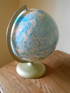 Cartographic World Globe. Vintage Rand McNally World Portrait Globe. This Cartographic globe is in nice condition with metal base. It has a