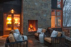 outdoor living with stone fireplace   Tish Key Interior Design