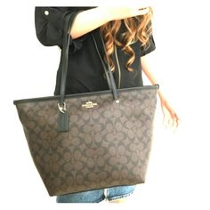 """COACH SIGNATURE STREET ZIP TOTE COACH LIGHT GOLD Dark Brown Cs on Brown Signature canvas with black leather trim Inside zip, cell phone and multifunction pockets Zip closure, fabric lining, Black leather Handles with 9.75"""" drop 16"""" (L) x 11"""" (H) x 7"""" (W) 100% AUTHENTIC COACH? Coach Bags Totes"""