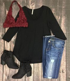 Keep it casual and cute this fall! We love this black cross neck top with a burgundy bralette!