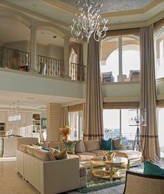 Mediterranean Living Room with sandstone tile floors, Copper crystal tripod chandelier floor lamp, Loft, High ceiling