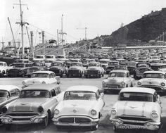 "There's a few nice Studebaker pickups in this photo.. a nice Packard...a bunch of Brand Xs.  ""American Cars In Venezuela – 1956."""