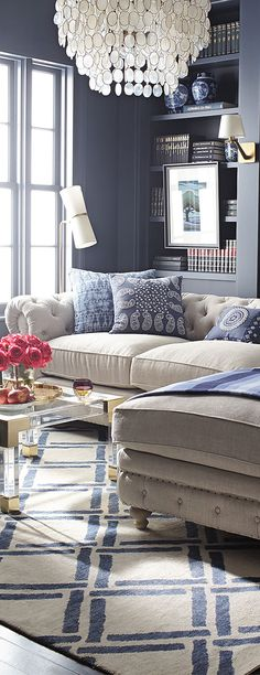 Linen Sectional Sofa with gorgeous blue walls and throw cushions.