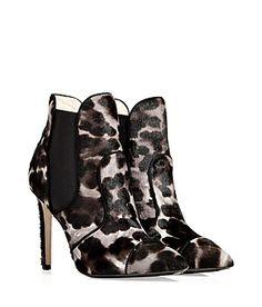 Glam up your cocktail-ready look with these incredibly luxe Emilio Pucci pony hair ankle boots featuring a bold animal print #Stylebop