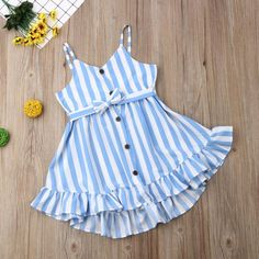 This super cute striped dress is perfect for any sunny day 😎 It's pretty sky blue and white stripes and ruffle bottom trim make this a go-to favorite! Toddler sizes Cute buttons Thin straps Bow detail on front Pink Toddler Dress, Baby Dress, Pink Dress, Frocks For Babies, Kids Tutu, Kids Dress Patterns, Girls Dresses, Summer Dresses, Stripes Fashion