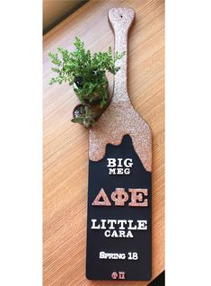 The paddle I made for my Big. Rose gold glitter, mod podge, black and white paint, and wooden letters Simple, easy, sorority, big little, drip paint, glitter, black, rose gold