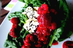 goat cheese on spinach salad with raspberry dressing