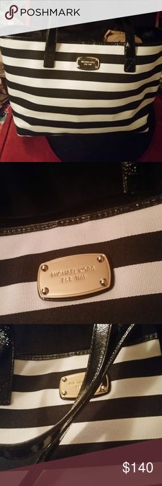 Gorgeous MK black and white striped tote MINT!! Gorgeous Michael Kors canvas and patent leather tote in striped black and white! Beautiful super roomy tote in excellent excellent condition! Michael Kors Bags Totes