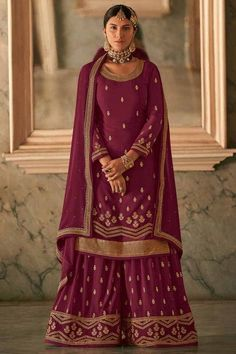 Look elegant when wearing this wine maroon georgette sharara suit which will definitely make other's envious of your look. This round neck and full sleeve party wear attire prettified with stone and zari work. Teamed up with georgette sharara pants in wine maroon color with wine maroon georgette dupatta. Sharara pants and dupatta embellished in stone and zari work. #shararasuits #malaysia #Indianwear #weddingwear #andaazfashion Sharara Suit, Patiala, Indian Attire, Indian Wear, Wedding Salwar Suits, Pantalon Cigarette, Bollywood Dress, Pakistani Suits, Festival Wear