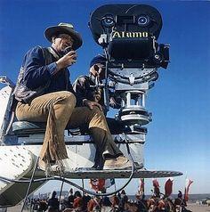 """John Wayne rides a crane shooting """"The Alamo"""". 1960."""