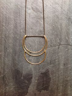 Gold Geometric Deco Hammered Planets Necklace -By Loop Jewelry- Sterling Silver Geometric-14K Gold-fill Geometric- Portland Jewelry-Crescent by LoopHandmadeJewelry on Etsy https://www.etsy.com/listing/190042178/gold-geometric-deco-hammered-planets
