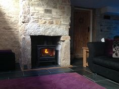Relax by the cosy wood burner at The Old Vicarage luxury self-catering in Godolphin Cross, Cornwall. Visit holidaylettings.co.uk/184008 to view the property Wood Burner, Luxury Holidays, Fishing Villages, Cornwall, Cosy, Countryside, Catering, Old Things, Relax