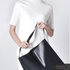 Sleek Ways Tote - a minimalist wardrobe essential carved out of genuine leather. Soft and versatile. Available now at wandererwanderer.com. Free shipping worldwide available.