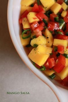 mango salsa the best summer salsa ever But made with Cilantro and onions instead of Chives! Love it!