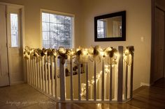 Burlap inspired banister, with fairy lights and baubles