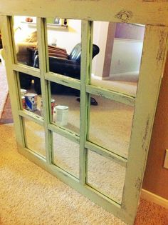 Antique painted mirror: 1. old bathroom mirror (45x43) 2. cedar beams cut to size 3. paint brown 4. rub a few areas with bar soap 5. paint green 6. sand 7. antique finish!