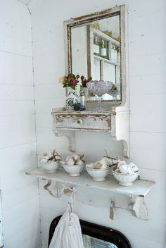 white shelf and mirror