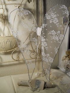 Angel Wings for Gloria, with this as inspiration...maybe stretch stripes of lace and weave them across a wire frame....allowing light to shine through it?