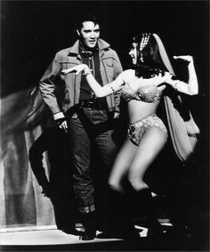 Elvis Presley as Charlie Rogers singing the song Little Egypt from his 1964 movie Roustabout. Wilda Taylor as Little Egypt